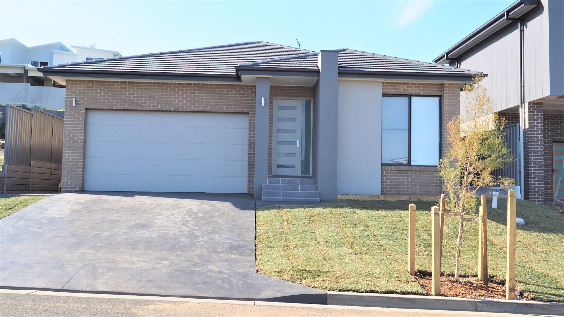 64 Saddleback Cres, Kembla Grange, NSW 2526