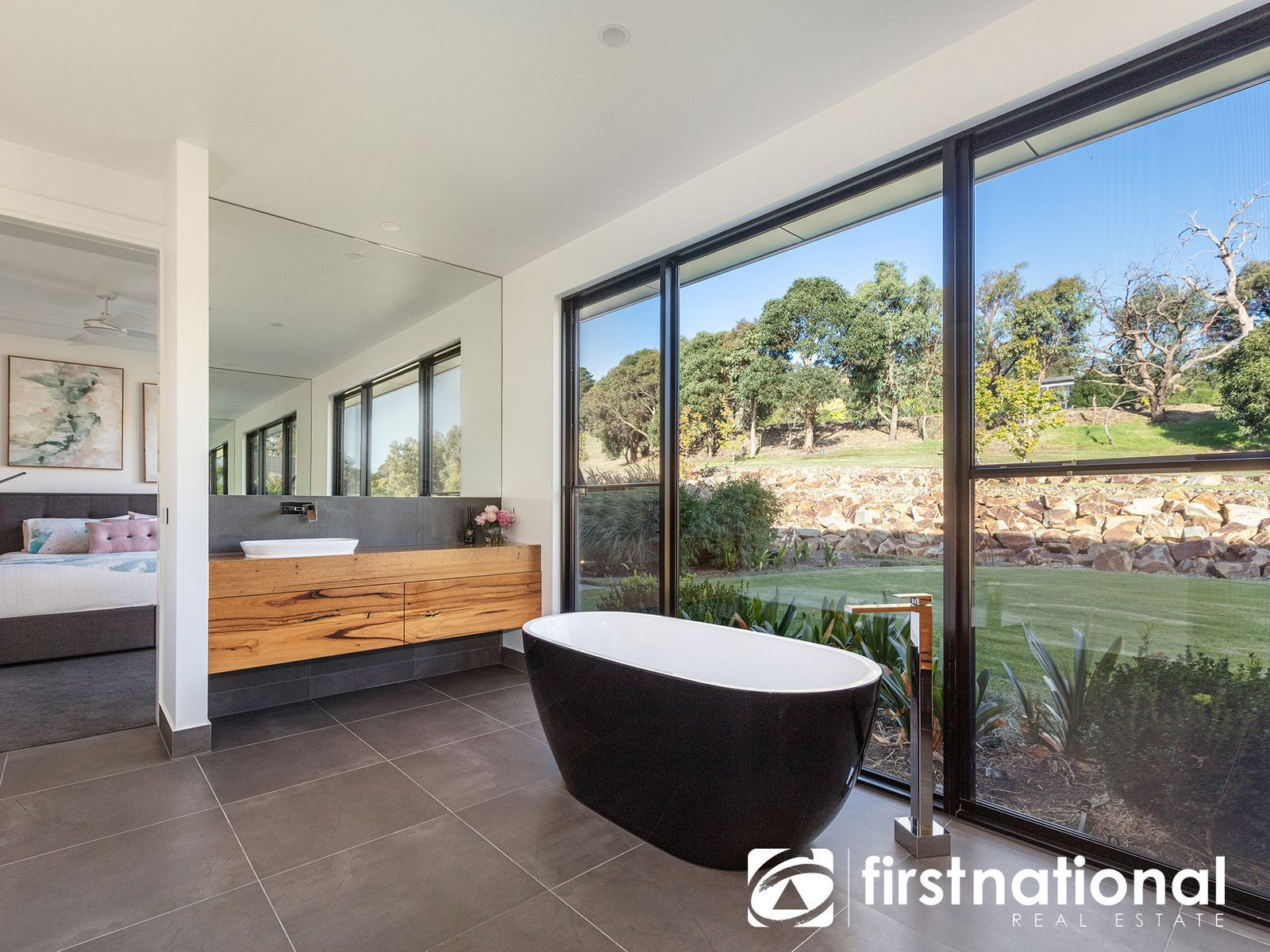 Master bedroom with adjoining ensuite and freestanding bath