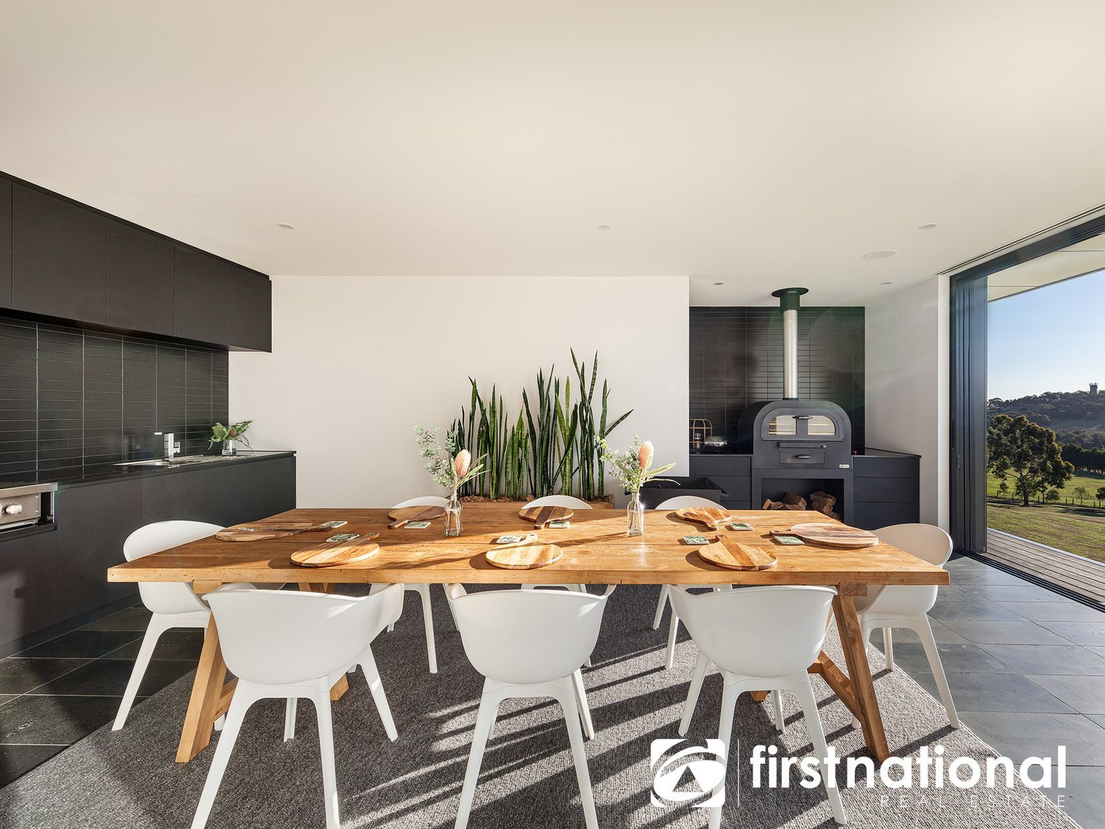 Beautiful alfresco area with dining table and pizza oven