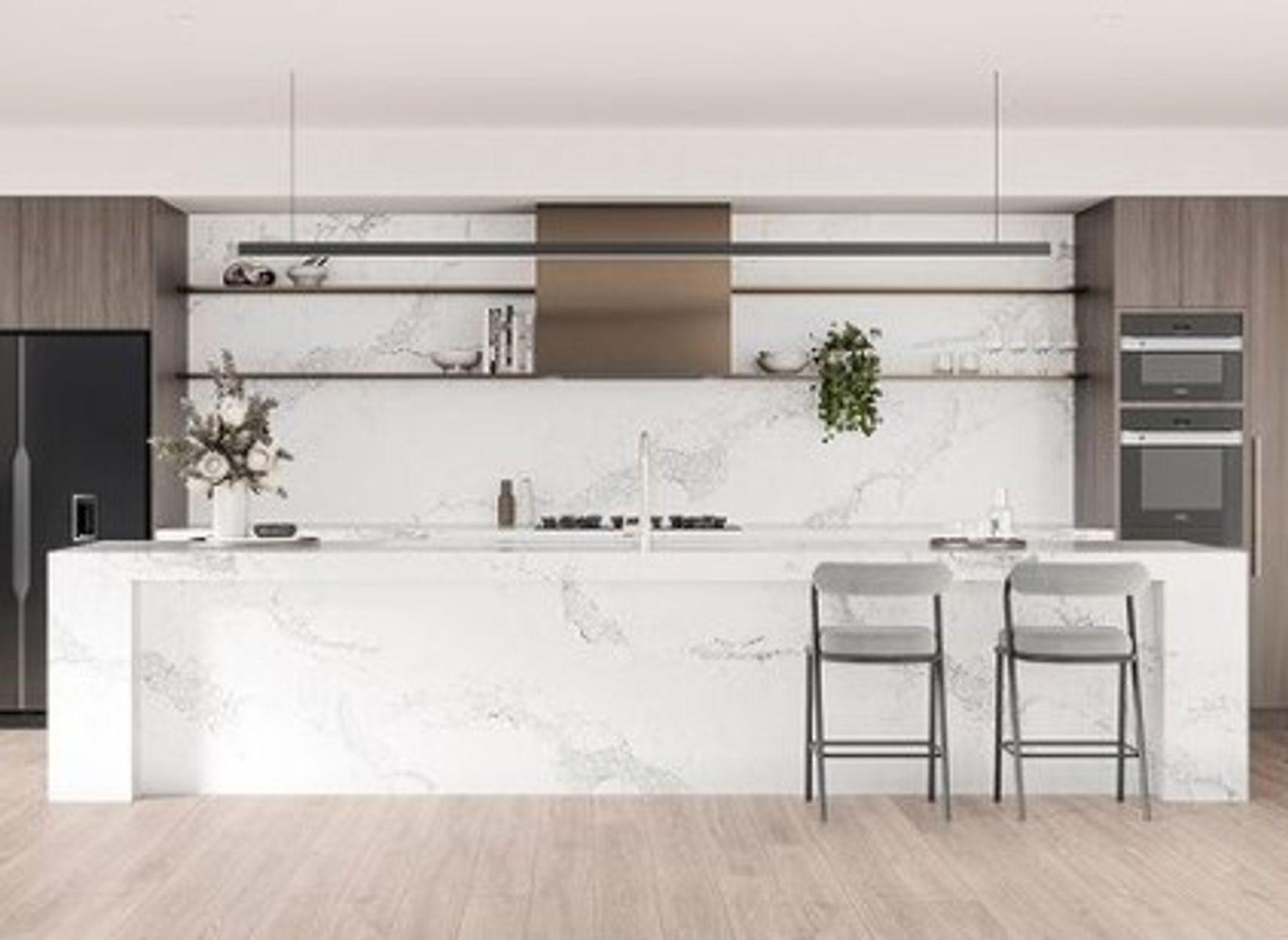 Beautiful kitchen with white stone bench and splashback
