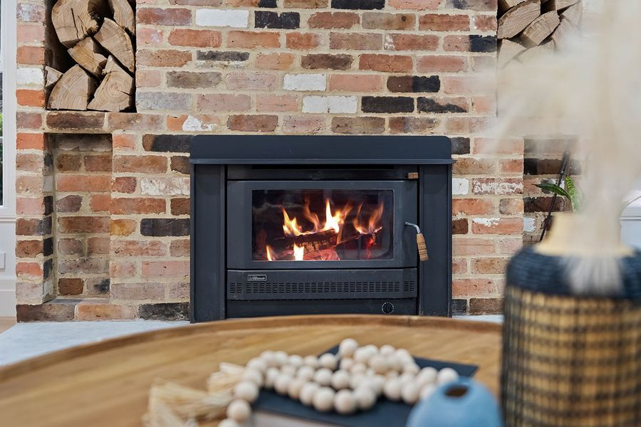Warm fire place in brick wall